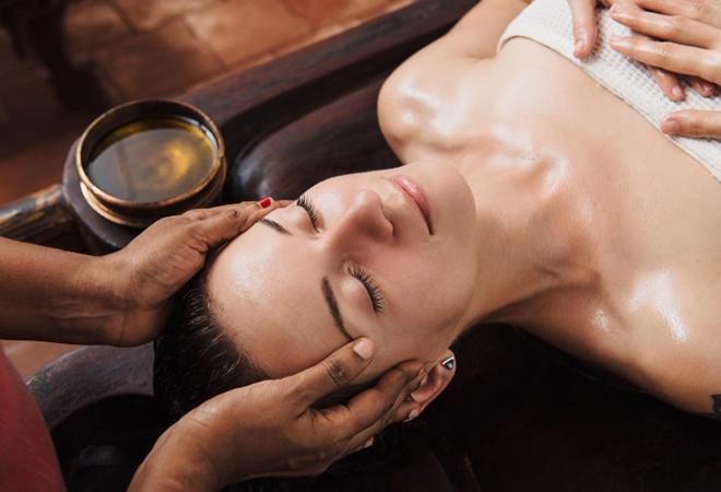 oil massage with Kumkumadi Tailam